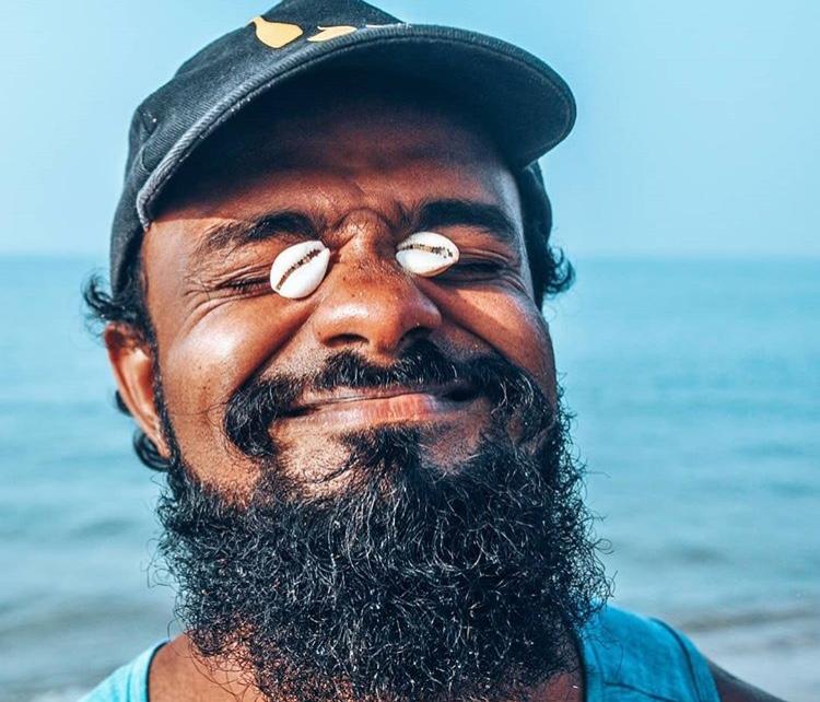 Sri Lankan Man kitesurfing Kalpitiya Sri Lanka