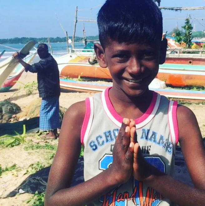 A young Buddhist boy in Weligama, Sri Lanka